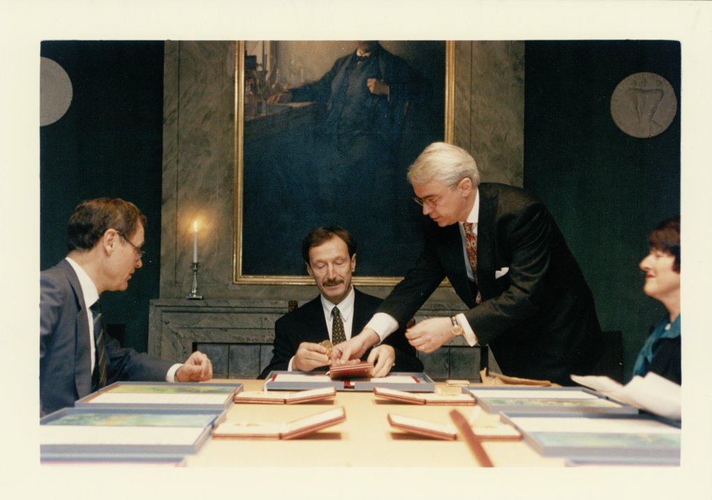 Rolf M. Zinkernagel looks at his Nobel Diploma