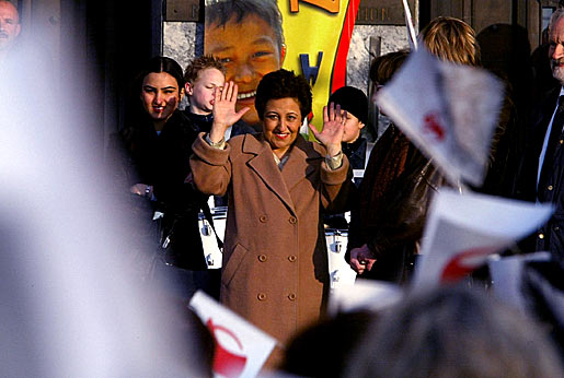Shirin Ebadi, waves to flag-waving children