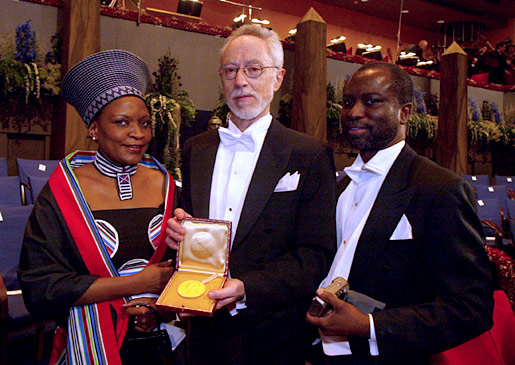 Nobel Laureate in Literature, John M. Coetzee, center. The South African ambassador to Sweden Sonto Kudjoe, left, and her husband Dr John Kudjoe, right, after the 2003 Nobel Prize Award Ceremony at the Stockholm Concert Hall.