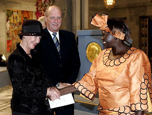 Nobel Peace Prize Laureate Wangari Maathai, right, shakes hands with Norway's Queen Sonja.
