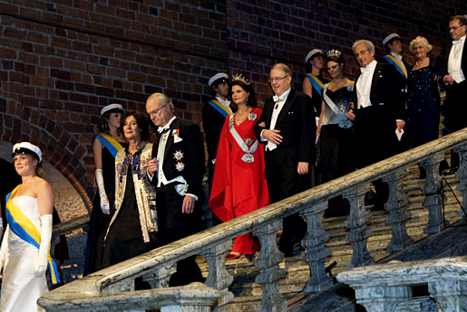 Albert Fert and Sweden's Crown Princess Victoria at the top of the stairs, descending into the Blue Hall of the Stockholm City Hall