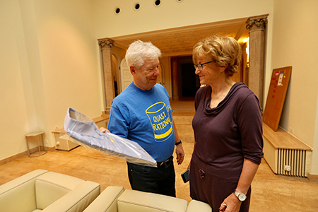 Richard Thaler consults his wife France Leclerc about which shirt to wear.