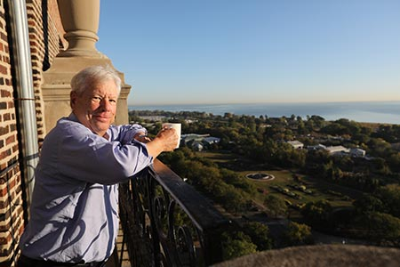 Richard Thaler stands on his back terrace