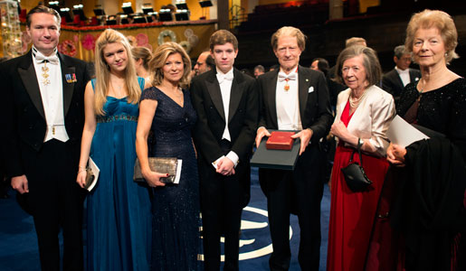 Sir John B. Gurdon with family and relatives on stage after the Nobel Prize Award Ceremony at the Stockholm Concert Hall