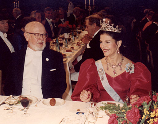 HM Queen Silvia of Sweden flashes a smile while conversing with William Alfred Fowler at the Nobel Banquet