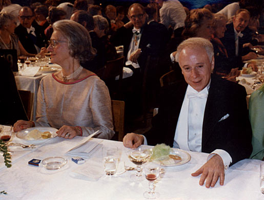 Joseph L. Goldstein seated beside a lady guest at the Nobel Banquet in the Stockholm City Hall