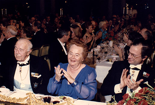 Gertrude B. Elion is flanked by HM King Carl XVI Gustaf and his uncle, HRH Prince Bertil of Sweden, at the Nobel Banquet in the Stockholm City Hall, Sweden, on 10 December 1988.