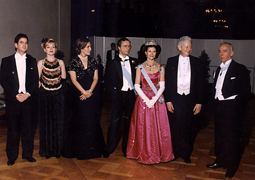 Their Majesties King Carl XVI Gustaf (center) and Queen Silvia of Sweden (third from right) pose with Leon Lederman (second from right) and his family. They are joined by Lars Gyllensten (right), Chairman of the Nobel Foundation and member of the Swedish Academy.