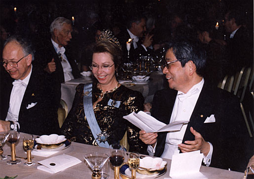 Princess Christina of Sweden shares a light moment with Reinhard Selten (left) and Kenzaburo Oe, Nobel Laureate in Literature (right), at the Nobel Banquet in the Stockholm City Hall