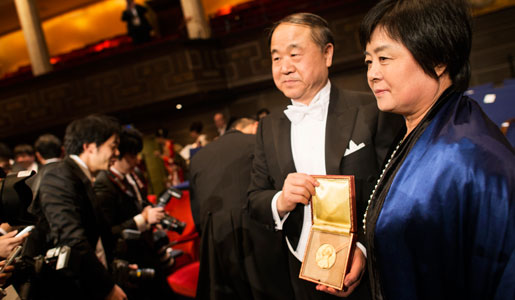 Mo Yan with his wife Mrs Qinlan Du, showing his Nobel Prize Medal after the Nobel Prize Award Ceremony