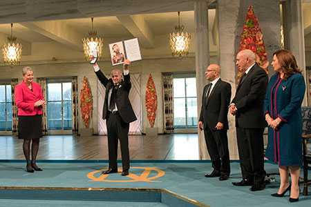 Representative of Tunisia's National Dialogue Quartet Houcine Abassi, Secretary General of The Tunisian General Labour Union, UGTT, showing the Nobel medal and diploma