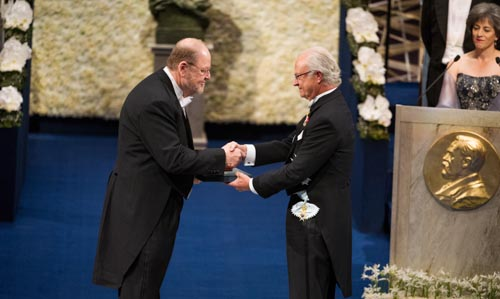 James E. Rothman receiving his Nobel Prize from His Majesty King Carl XVI Gustaf of Sweden