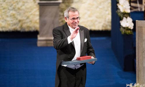 A wave to the audience. Arieh Warshel after receiving his Nobel Prize at the Stockholm Concert Hall
