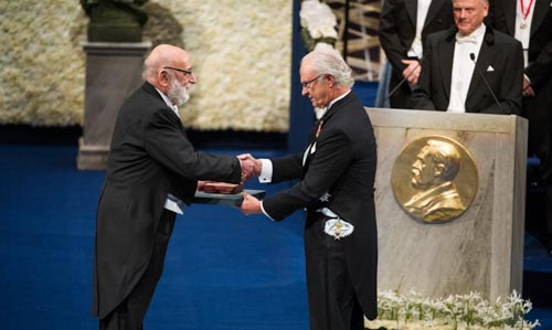 François Englert receiving his Nobel Prize from His Majesty King Carl XVI Gustaf of Sweden