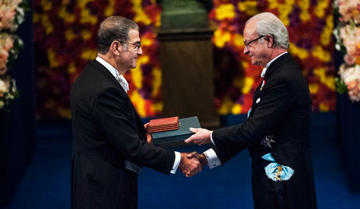 Serge Haroche receiving his Nobel Prize from His Majesty King Carl XVI Gustaf