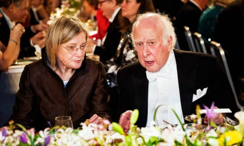 Peter Higgs in a conversation with Mrs Marci Hazard at the table of honour.