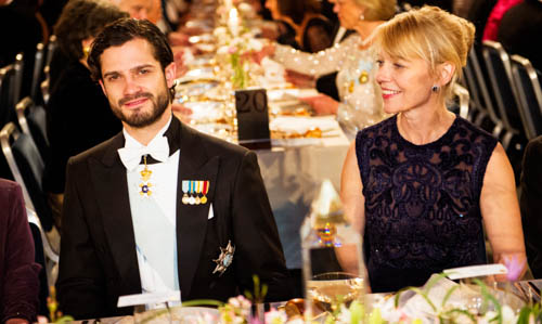 Prince Carl Philip of Sweden and Mrs Jenny Munro, daughter of Literature Laureate Alice Munro, at the Nobel Banquet.