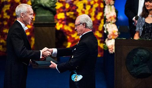 Brian K. Kobilka receiving his Nobel Prize from His Majesty King Carl XVI Gustaf