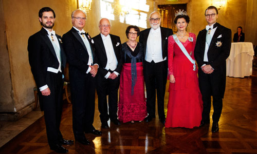 The Swedish Royal Family receive the Laureates and their significant others in the Prince's Gallery after the Nobel Banquet. From left to right: Prince Carl Philip, His Majesty King Carl XVI Gustaf of Sweden, Nobel Laureate Peter Higgs, Mrs Mira Nikomarow, Nobel Laureate François Englert, Her Majesty Queen Silvia and Prince Daniel.