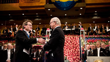 Bernard L. Feringa receiving his Nobel Prize from H.M. King Carl XVI Gustaf of Sweden