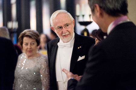 Arthur B. McDonald and his wife, Mrs Janet McDonald, talking to Physics Laureate Takaaki Kajita.