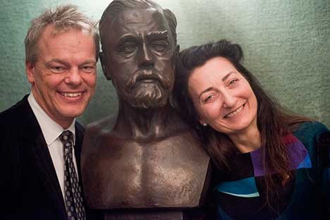 Edvard I. Moser and May-Britt Moser beside a bust of Alfred Nobel's nephew Emanuel Nobel, during their visit to the Nobel Foundation, on 12 December 2014.