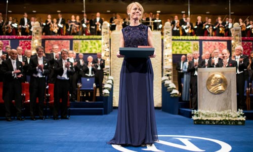 Mrs Jenny Munro after receiving the Nobel Medal and Diploma on behalf of her mother Alice Munro at the Stockholm Concert Hall
