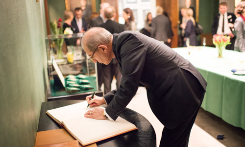 Ahmet Üzümcü, Director-General of Organisation for the Prohibition of Chemical Weapons (OPCW), signing the guestbook at the Nobel Foundation