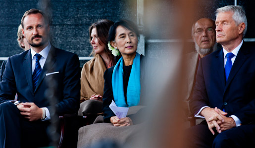 Aung San Suu Kyi in the first row, Crown Prince Haakon (left) and Thorbjørn Jagland, Chairman of the Norwegian Nobel Committee (right), on stage during the celebration in downtown Oslo on 16 June 2012