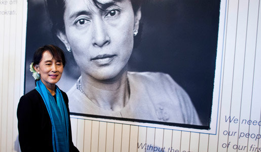 Aung San Suu Kyi in front of a photo of herself at the exhibition at Nobel Peace Center in Oslo