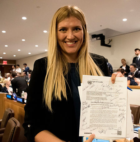 Beatrice Fihn with the signed UN Treaty