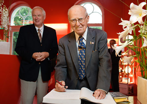 Norman Borlaug signing the guest book