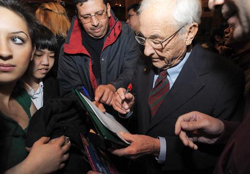 Willard S. Boyle signing autographs