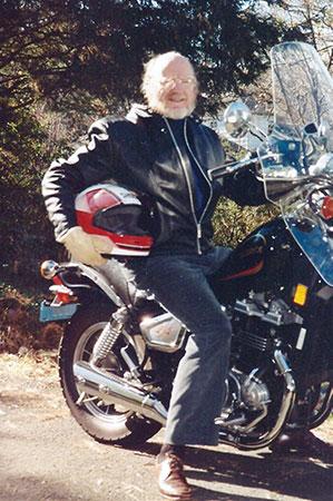 On a motorbike.