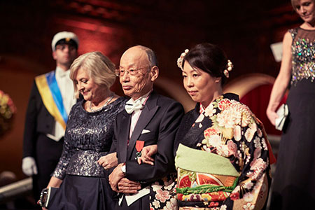 Satoshi Ōmura proceeds into the Blue Hall of the Stockholm City Hall for the Nobel Banquet.