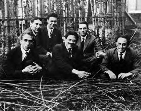 Ehrenfest's students: Gerhard Heinrich Dieke, Samuel Abraham Goudsmit, Jan Tinbergen, Paul Ehrenfest, Ralph Kronig, and Enrico Fermi. Licensed under Public domain via Wikimedia Commons