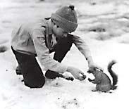 Boy and squirrel.