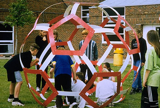 Schoolchildren in Sussex constructing a giant buckyball out of plastic strips