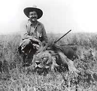 Ernest Hemingway with a lion.