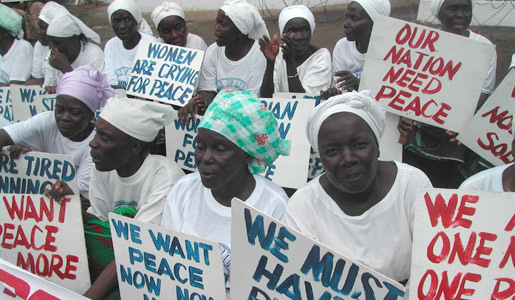 Liberian women demonstrate at the American Embassy in Monrovia at the height of the civil war in July 2003