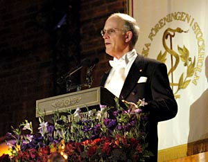 David J. Gross delivering his banquet speech.
