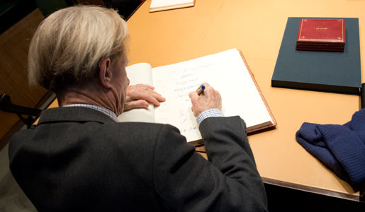 Sir John B. Gurdon visits the Nobel Foundation on 12 December 2012 and signs the guest book