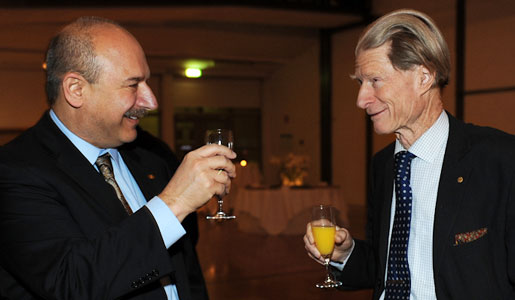 Sir John B. Gurdon (right) is greeted by Bruce A. Beutler, 2011 Nobel Laureate in Physiology or Medicine, at a reception at Karolinska Institutet
