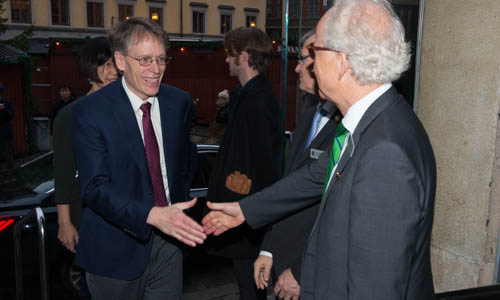 Lars Peter Hansen arrives at the Nobel Museum in Stockholm and is greeted by Lars Heikensten, Executive Director of the Nobel Foundation