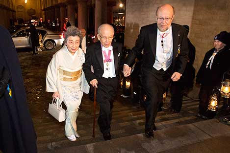 Isamu Akasaki arrives at the Nobel Banquet at the Stockholm City Hall on 10 December 2014, together with his wife, Mrs Ryoko Akasaki.
