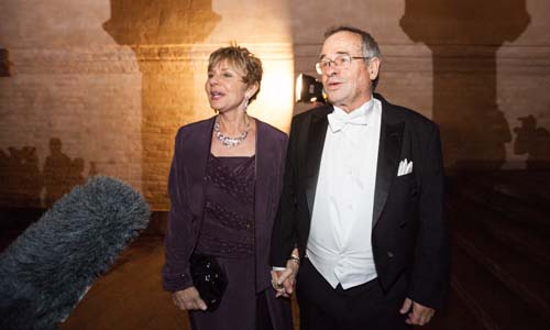 Arieh Warshel and Mrs Tamar Warshel arrive at the Nobel Banquet at the Stockholm City Hall on 10 December 2013.