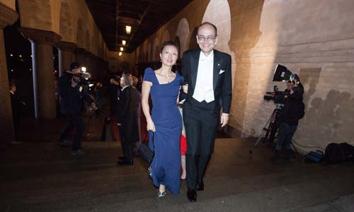 Thomas C. Südhof arrives at the Nobel Banquet in the Stockholm City Hall together with his wife, Mrs Lu Chen, 10 December 2013