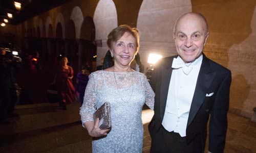 Eugene F. Fama and Mrs Sallyann Fama arrive at the Nobel Banquet at the Stockholm City Hall on 10 December 2013