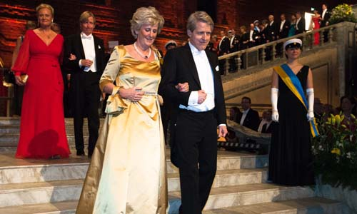 Robert J. Shiller and Catharina Lindqvist proceed down the stairs to the Nobel Banquet in the Blue Hall of the Stockholm City Hall on 10 December 2013.