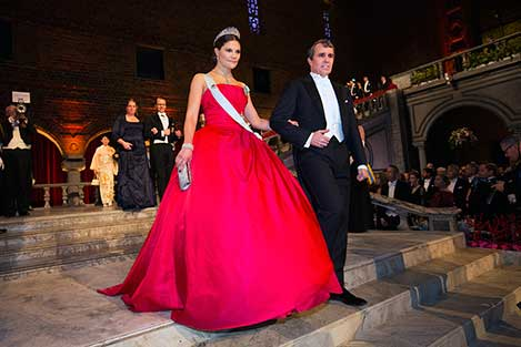 Sweden's Crown Princess Victoria and Eric Betzig proceed into the Blue Hall of the Stockholm City Hall for the Nobel Banquet.